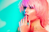 Fashion model woman in colorful bright lights, portrait of beautiful party girl with trendy make-up, poster