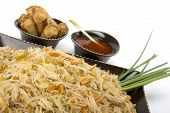 pic of pancit  - Pancit on a ceramic dish with egg rolls and sweet and sour sauce