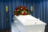 pic of mortuary  - A white coffin in a mortuary with a flower arrangement - JPG