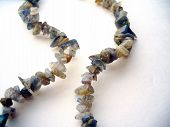 foto of labradorite  - Photo shows the variety of color and shape of labradorite beads on string - JPG