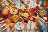 Happy Thanksgiving Day! Autumn feast. Family sitting at the table and celebrating holiday. Tradition poster
