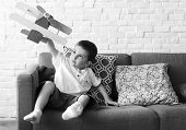 Boy Playing Plane Toy Aspiration poster