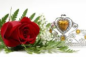 stock photo of beauty pageant  - Photo of a Red Rose and Tiara Crown  - JPG