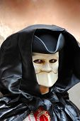 stock photo of gruesome  - portrait of male adult doll in scary mouthless mask on street in Venice Italy - JPG