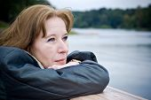 stock photo of casual woman  - Portrait of attractive mature woman dreaming about something pleasant - JPG