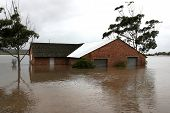foto of flood  - Flooded store room building with water half way up it - JPG