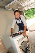 picture of washing machine  - Plumber fixing washing machine - JPG