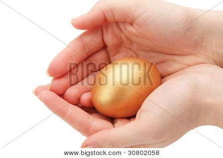 A golden egg in a female hand