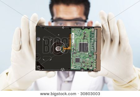 Scientist With Computer Hard disk