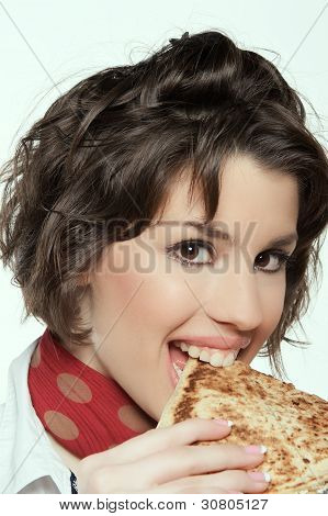 Woman eating quesadilla