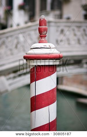 Red And White Dock Post In Venice