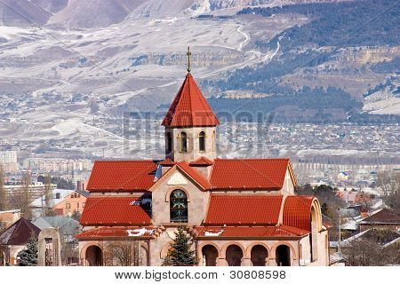Surb Vardan Church And Caucasus Mountains.
