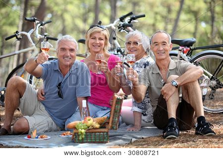 Two couple having picnic whilst on bike ride
