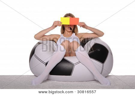 Football and soccer supporter with red and yellow cards