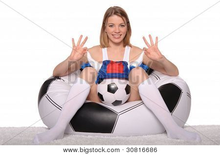 happy football and soccer fans in an armchair