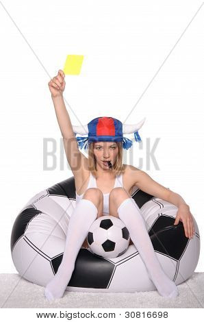 Football and soccer supporter showing yellow card