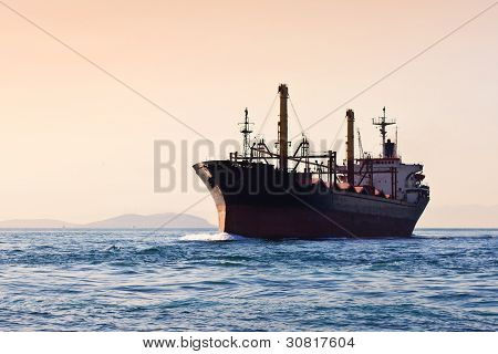 Silhouette of cargo ship