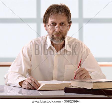 Man Behind A Desk
