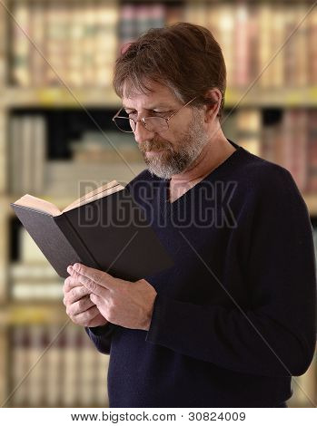 Elderly Man Reading A Book