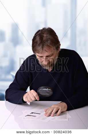 Man Studies The Financial Report