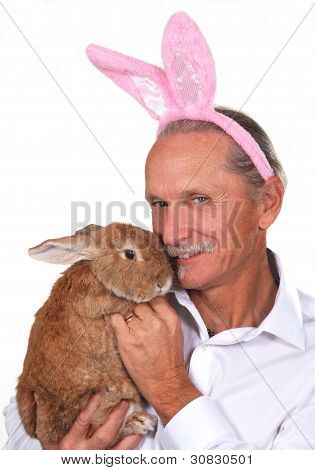 Man Holding Rabbit, Wearing Pink Rabbit Ears