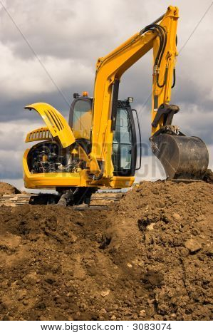 Excavator Standing On Soil With Open Engine
