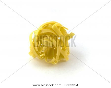 Small Twist Of Pasta Tagliatelli On White Background