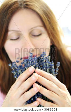 Woman Smelling Lavender