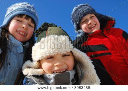 Three Kids Outside In Winter