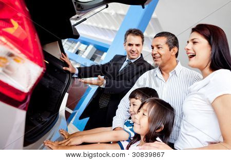 Family at the dealership buying a new car