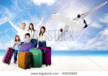 Excited family with arms up enjoying their vacations
