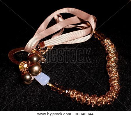 Beautiful gold jewelry on a black background