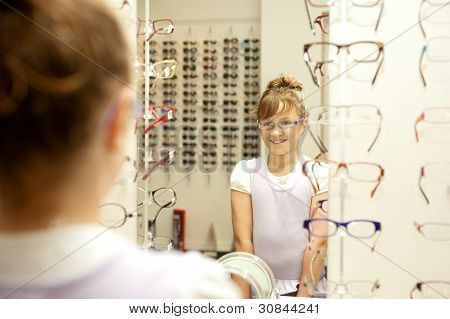 A Young Girl Choosing New Glasses