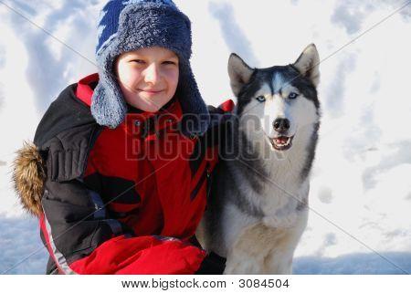 Boy With Husky Dog