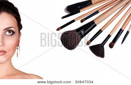 Woman Portrait With Makeup Brushes