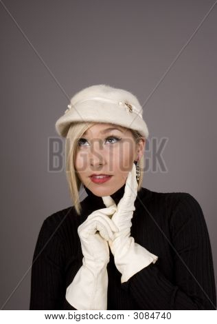 Blonde Fur Hat Hand On Chin Looking Up
