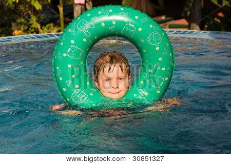 Boy With A Rubber Ring In The Pool