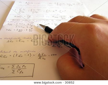A Hand Holding A Pen With Page In Background