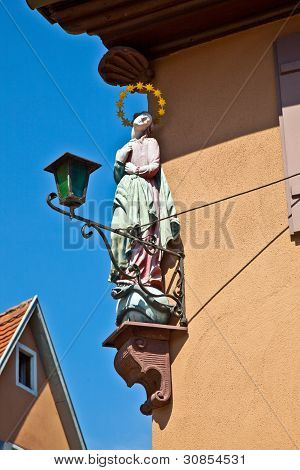 Holy Christian Figure With Gloriole On A Housewall In  Medieval Town Of Dinkelsbuehl In Bavaria, Ger