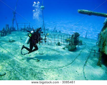 Underwater Photographer Shooting A Sunken Shipwreck