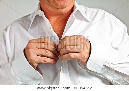 Man Closing His Shirt