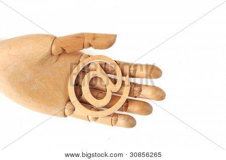 wooden mannequin's hands, holding email symbols