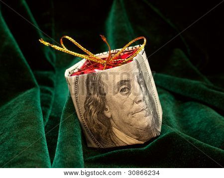 The Christmas Toy Wrapped In The Dollar Bill