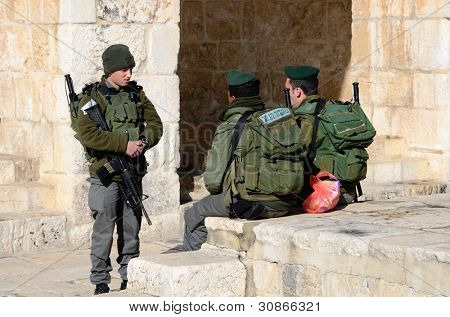 JERUSALEM - FEBRUARY 20: Israeli Border Police chat February 20, 212 in Jerusalem, IL. Known as Magav in Hebrew, their main task is securing Israel's borders.