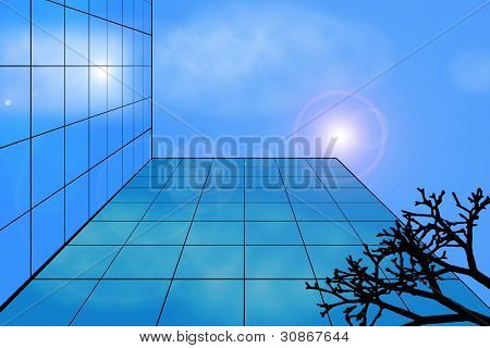 Modern Building Against The Sky And Cloud Reflection In Its Windows