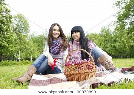 Mother and daughter relaxing outdoors