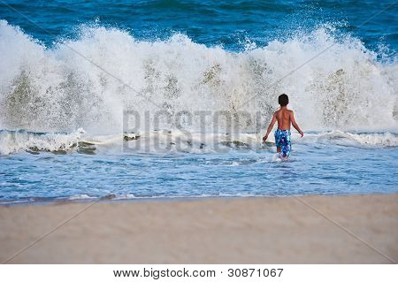 Boy Playing in the Atlantic Ocean