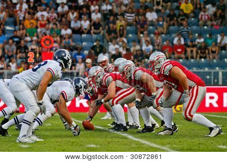 GRAZ, AUSTRIA - JULY 13 Teams France and Austria at the line of scrimmage at the Football World Championship on July 13, 2011 in Graz, Austria. France wins 24:16 against Austria.
