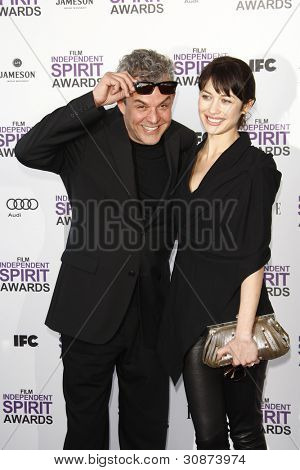 SANTA MONICA, CA - FEB 25: Danny Huston; Olga Kurylenko at the 2012 Film Independent Spirit Awards on February 25, 2012 in Santa Monica, California