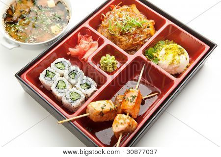 Japanese Meal in a Box (Bento) - Salad, Skewered Salmon and Sushi Roll and Dessert